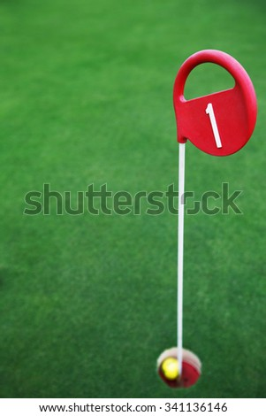 Golf ball at the hole - stock photo