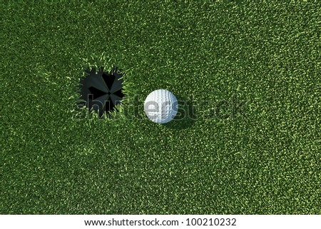 Golf ball go to the hole on lip of cup on green grass - stock photo
