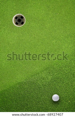 golf ball hole on a field - stock photo