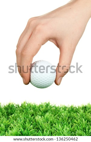Golf ball in hand isolated on white