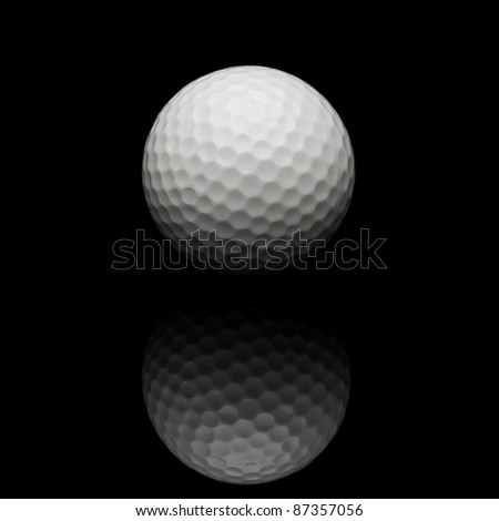 Golf ball isolated on black background - stock photo