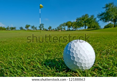 golf ball lies on edge of green - stock photo
