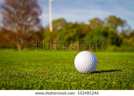 Golf ball on beautiful golf course