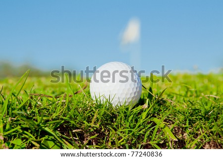 golf ball on edge of bunker close up - stock photo