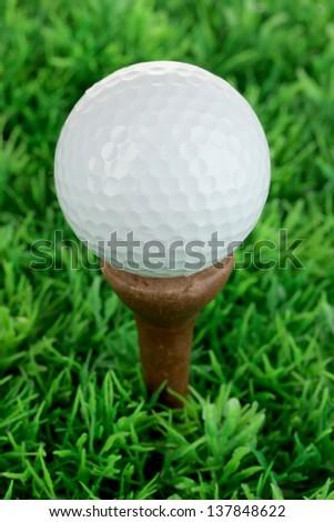 Golf ball on grass close up - stock photo