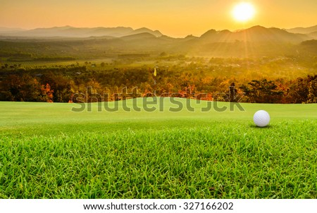 golf ball on green. - stock photo