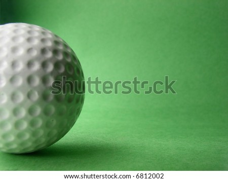 Golf ball on green background, space for text