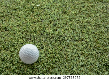 Golf ball on green copy space
