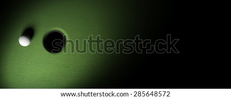 Golf ball on green turf banner - stock photo