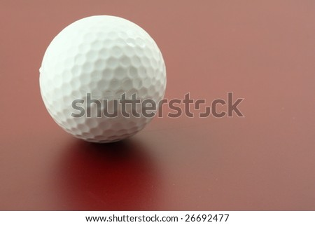 golf ball on red - stock photo