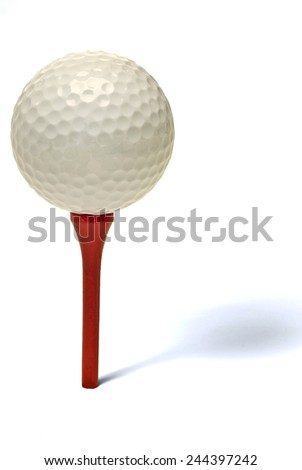 Golf Ball On Red Tee With Shadow On White Background - stock photo