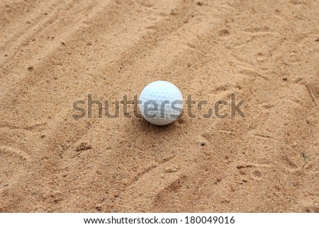 Golf ball  on sand in bunker  golf course  - stock photo