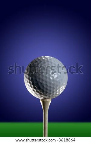 Golf ball on tee - stock photo