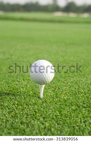 Golf ball on tee,atmosphere morning,There is space on the left and right for adding text. - stock photo