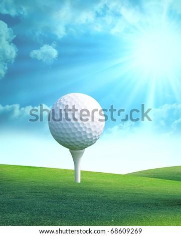 Golf ball on tee in golf club - stock photo