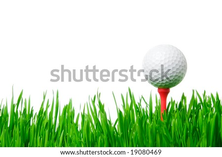 Golf ball on tee on green grass isolated on white background.