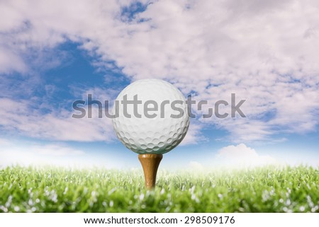 Golf ball on tee pegs in sky