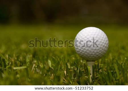 Golf ball on tee with a blurred background