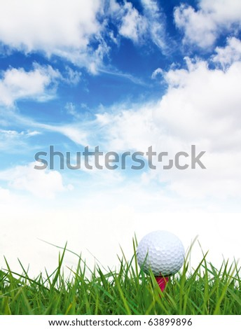 Golf ball on the green grass and blue sky. - stock photo