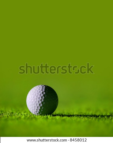 Golf Ball on the Green Grass with green background - great for cover page - stock photo