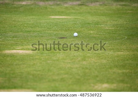Golf ball on the lawn, green