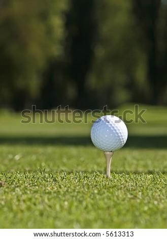 Golf ball set against green grass - stock photo