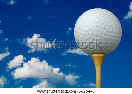 Golf Ball & Tee on the right with clouds and sky background. - stock photo