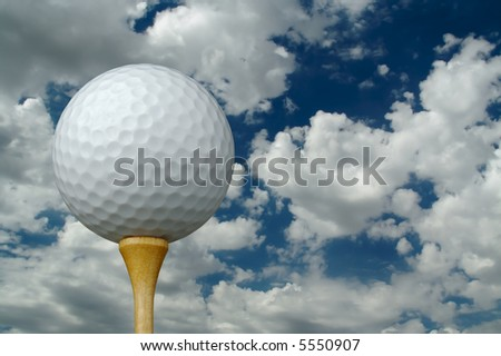 Golf Ball & Tee with clouds and sky background. - stock photo
