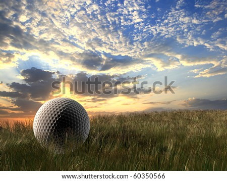 Golf ball under cloudy sky - stock photo