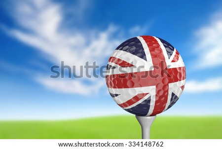 Golf ball with United Kingdom flag colors sitting on a tee - stock photo