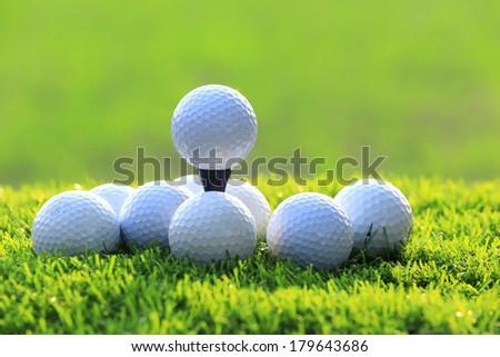 Golf Balls on course green grass - stock photo