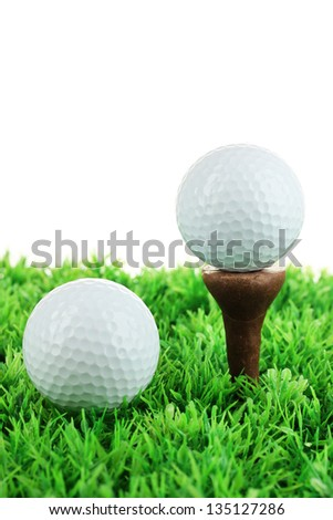 Golf balls on grass isolated on white