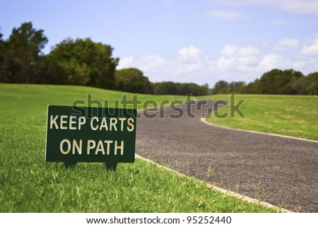 Golf cart path and sign - stock photo