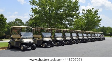 Golf carts at course background - stock photo