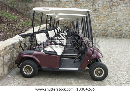 Golf carts in one's series - stock photo