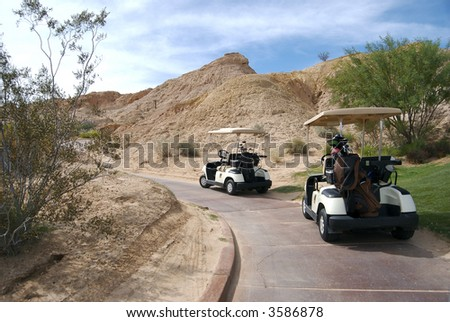 Golf carts on paved path - stock photo