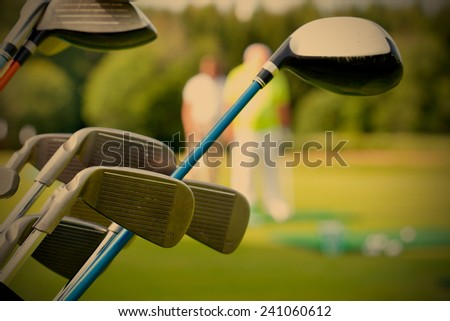 golf club against the background of green field, instagram image style - stock photo