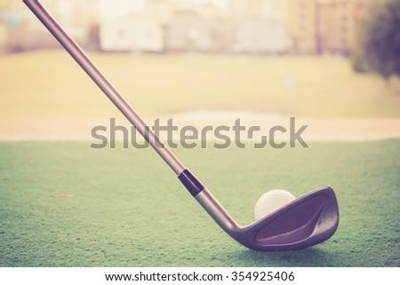 golf club and ball at driving range  - stock photo