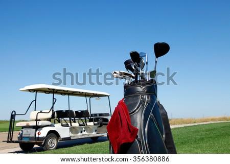 Golf club and golf car - stock photo