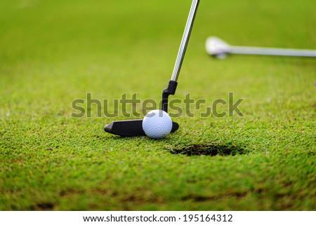 Golf club close up on green - stock photo