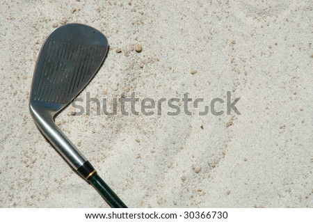 Golf club laying in sand - stock photo