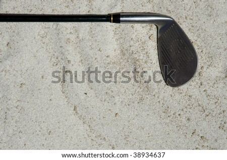 golf club laying in sand room for your text - stock photo