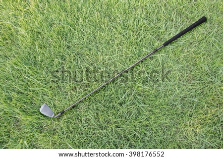 Golf club on green grass