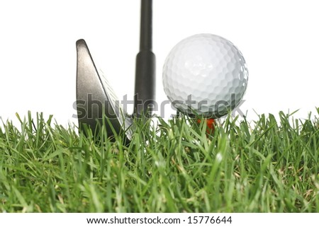Golf club with golf ball on a tee and grass with a white background.