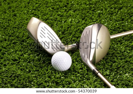 Golf clubs(driver) on grass with golf ball on tee close up - stock photo