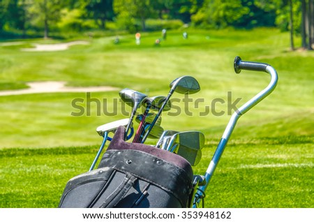 Golf clubs in the bag at the beautiful golf course. Fragment.d - stock photo