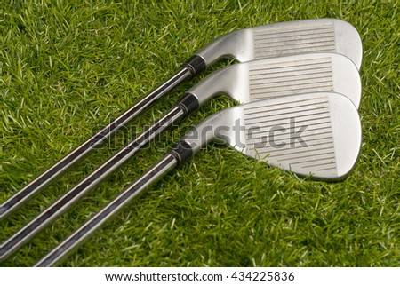Golf clubs with steel shaft on grass. - stock photo