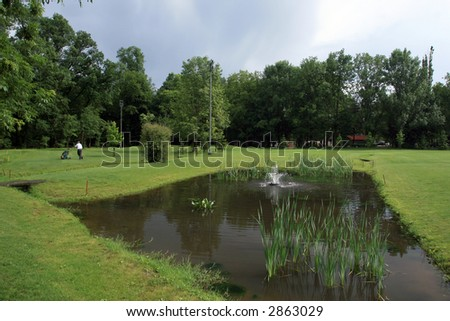 Golf course and a pond - stock photo