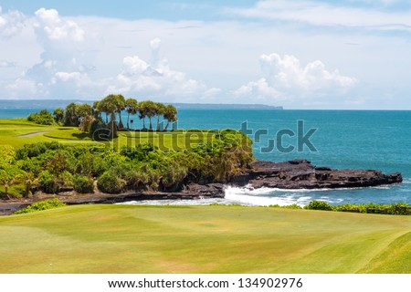 Golf course and the blue ocean in the background - stock photo