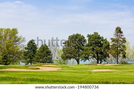 Golf course at a lake - stock photo